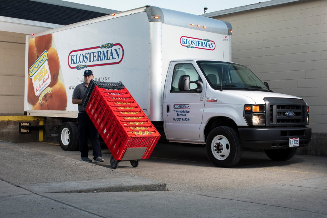 A klosterman bakery worker delivering good in a truck