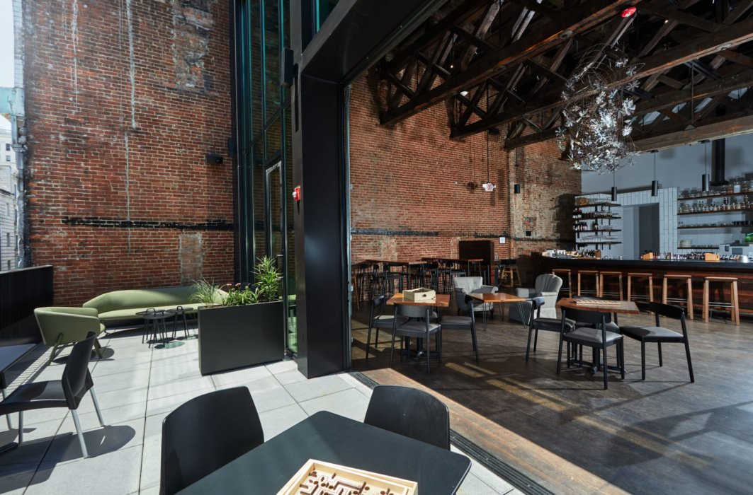 Alternate view of Cafe dining area with architectural accents split indoor outdoor