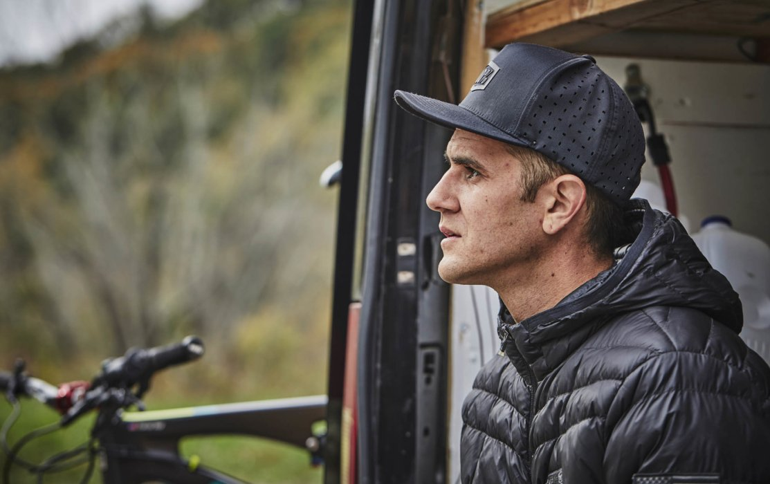 Portrait of Cyclist Trevor Gay sitting at his van