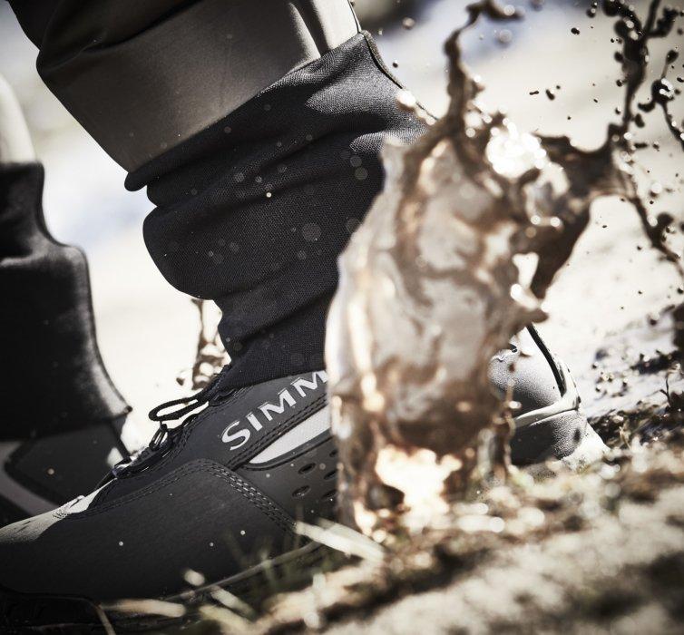 A hikers book splashing mud