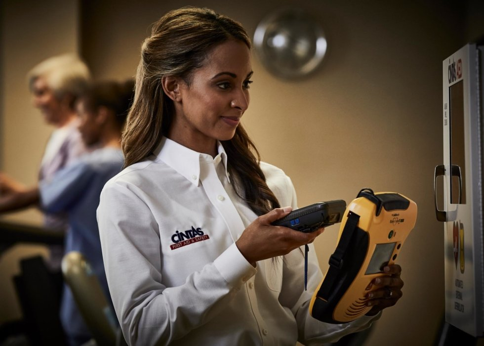 A woman using a scanner at a workplace - workplace photography