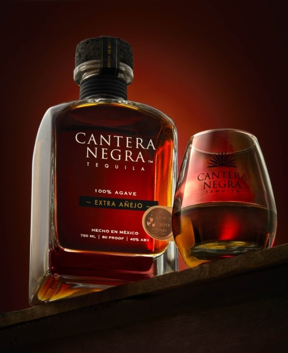 Red glowing cantera negra tequila extra anejo