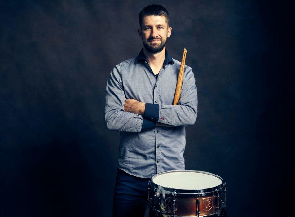 Portrait of a man with drum and drum sticks - convert nova