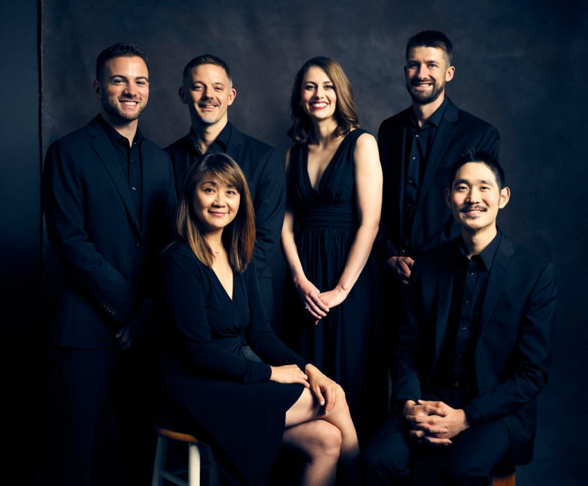 Group portrait of Concert Nova wearing black