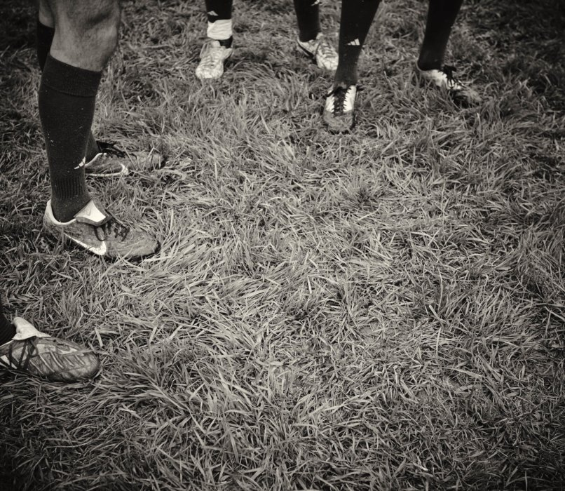 Athletes on a field featuring shoes