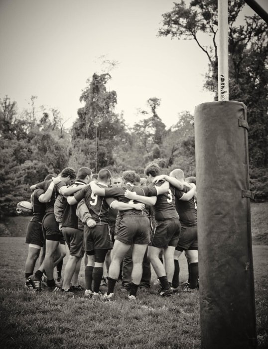 Young athletic rugby players in a huddle