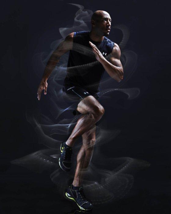 An athlete running with smoke around him