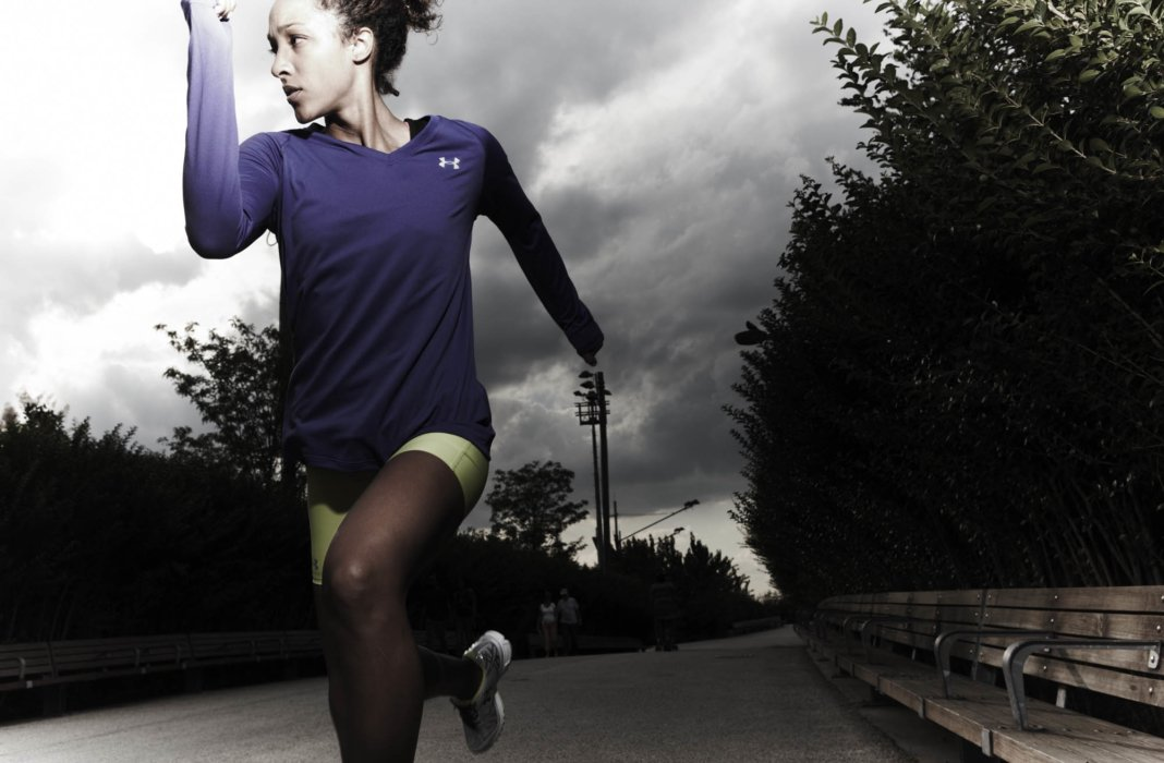 A young woman athlete running on a road