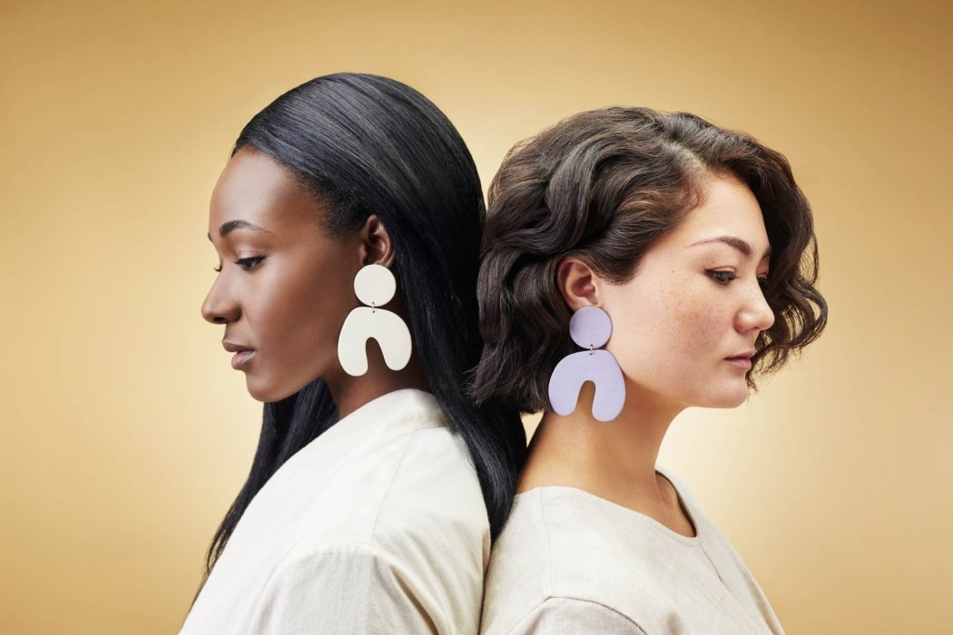 Two women wearing high-end ceramic earings