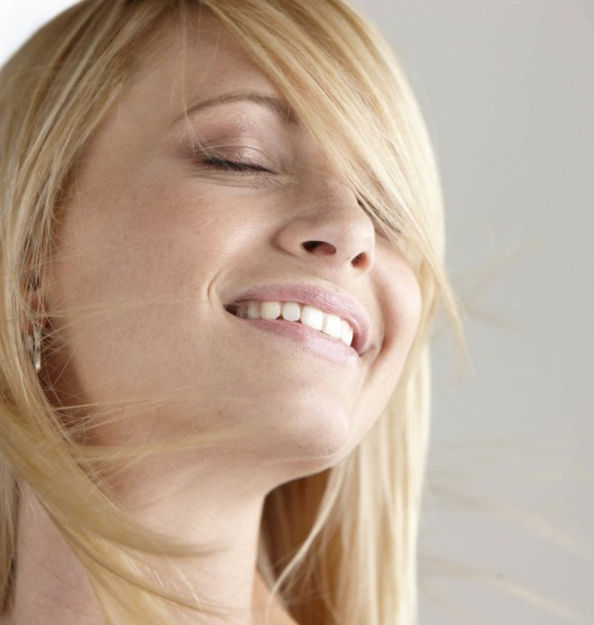 a beauty shot of a woman smiling