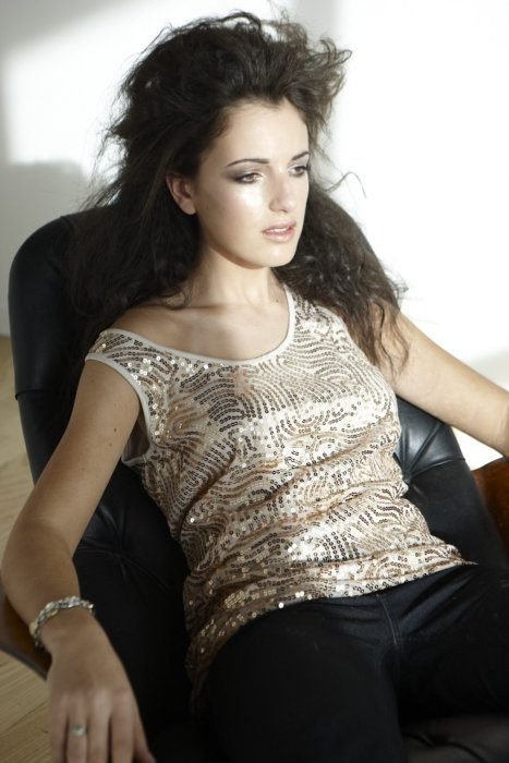 Beauty and fashion shot of a woman on a chair looking dazed