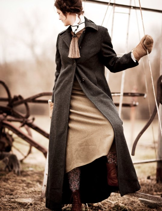 A fashion model wearing 1800's western clothes dress