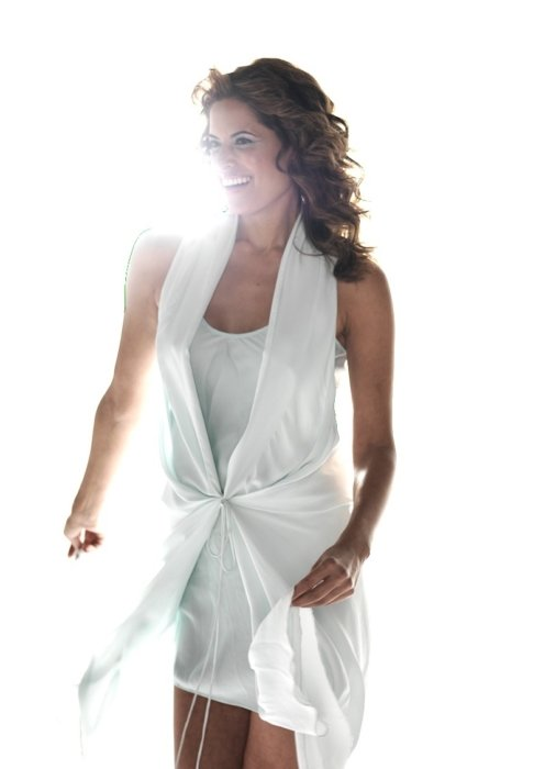 A fashion model with lots of white light and a white dress