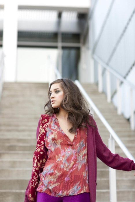 A fashion model wearing bright clothes on industrial steps