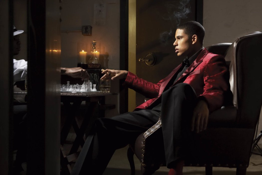 A man wearing a smoking jacket with cigar