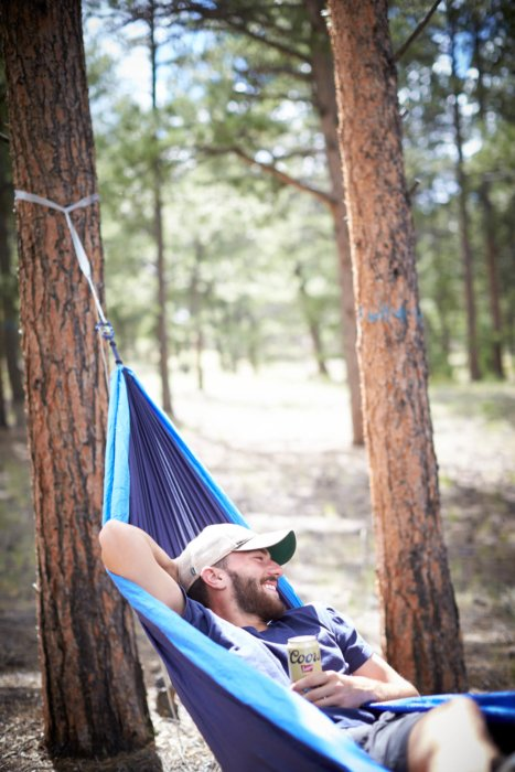 Camping with hammock and beer