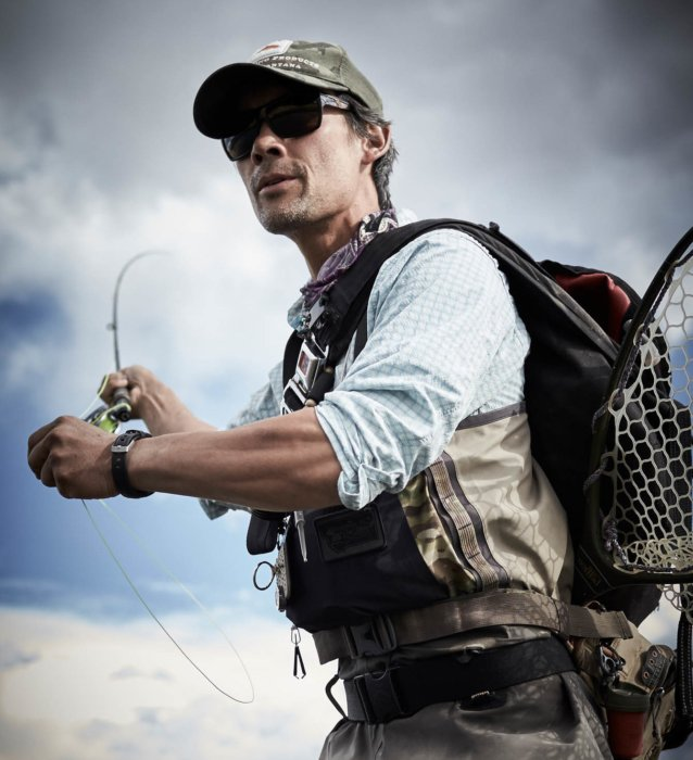 Fly fisherman in a casting pose