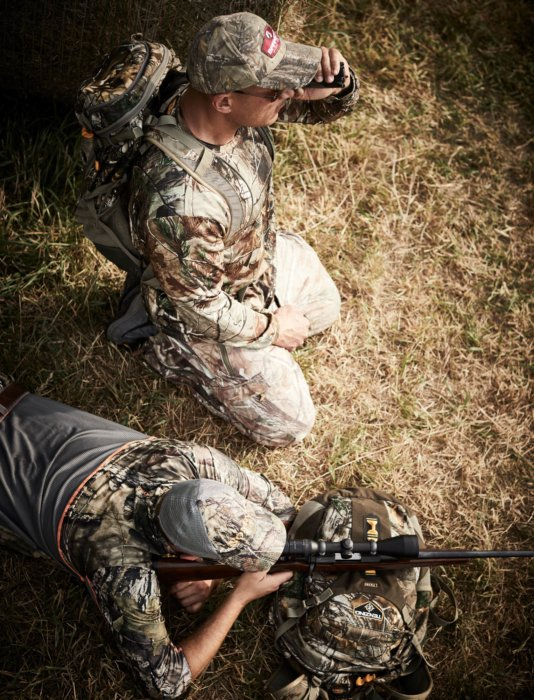 Two hunters teaming up on a long range rifle shot