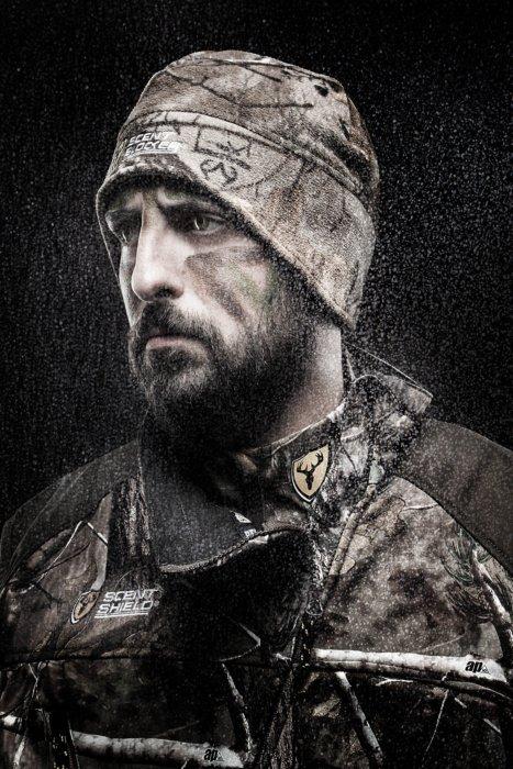 Portrait of a bearded hunter in full sent shield gear