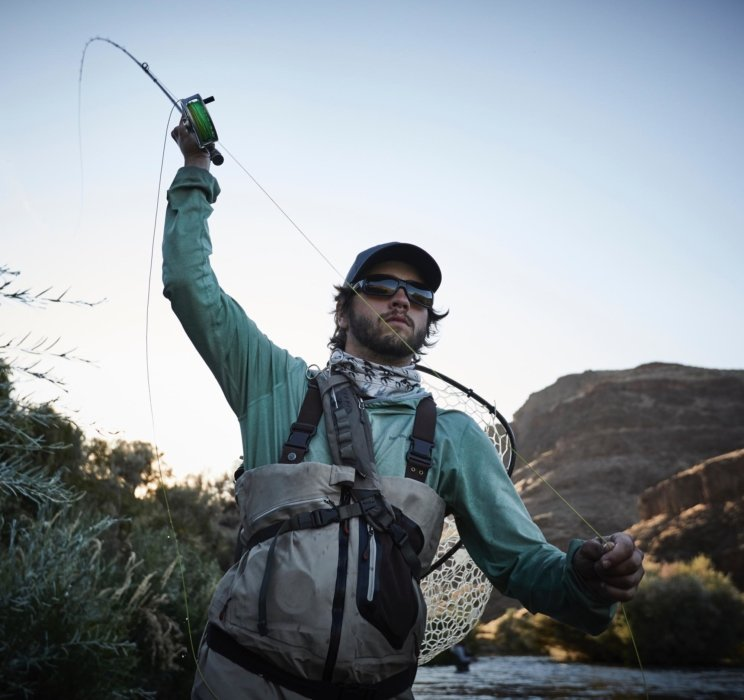 A fly fisherman mid cast