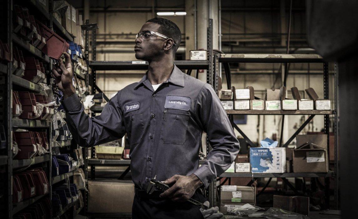 A man organizing parts at an industrial facility