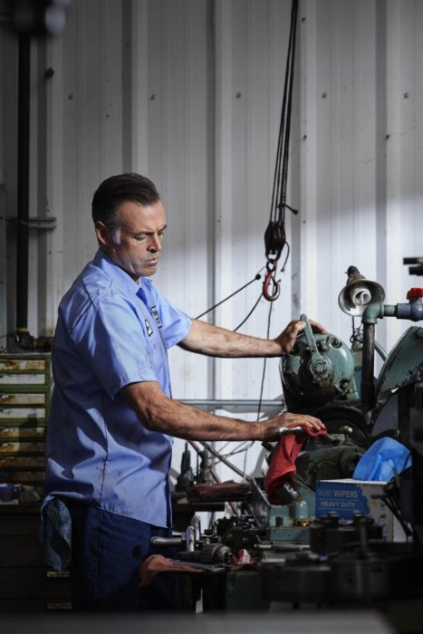 A man working in a mechanics shop