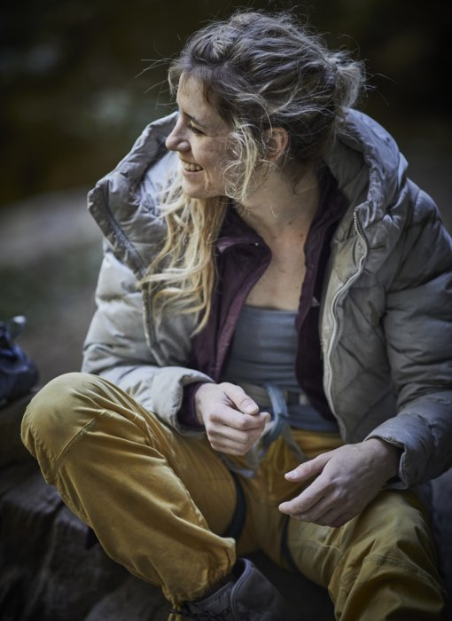 A female rock climber taking a break