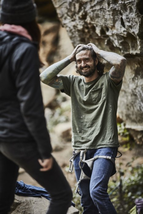 A lifestyle of a male rock climber smiling
