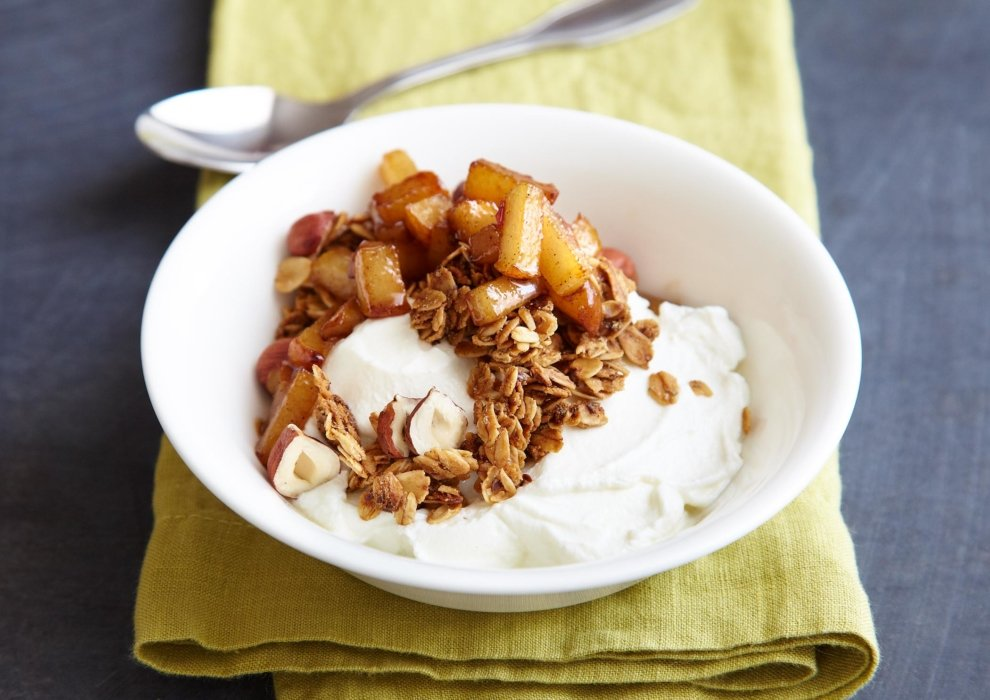 A bowl of fruit granola and yogurt