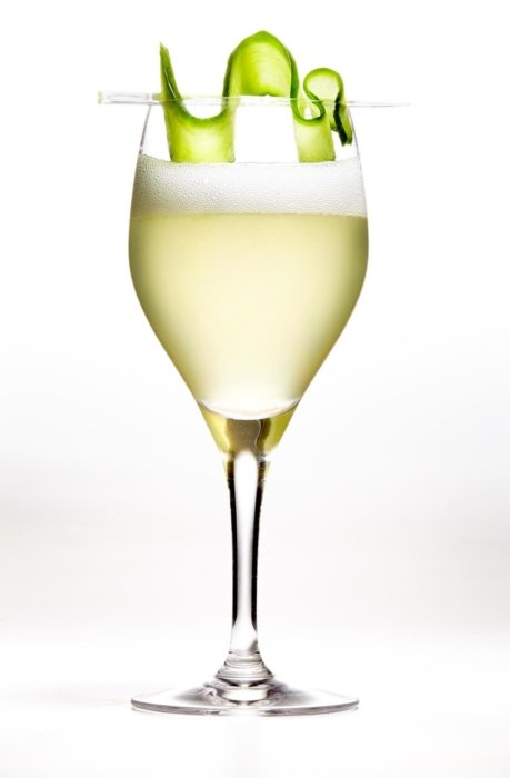 A green cocktail drink on a white background