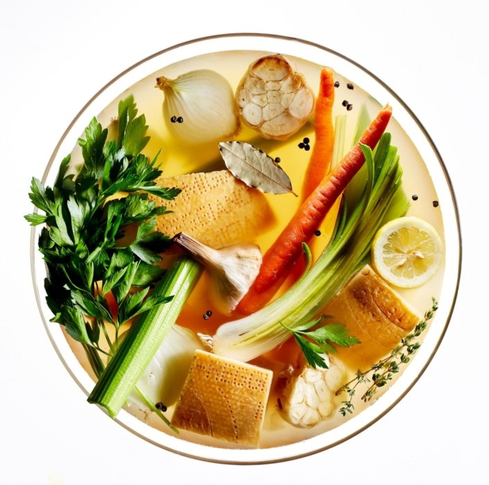 Raw vegetables and fruit in a bowl