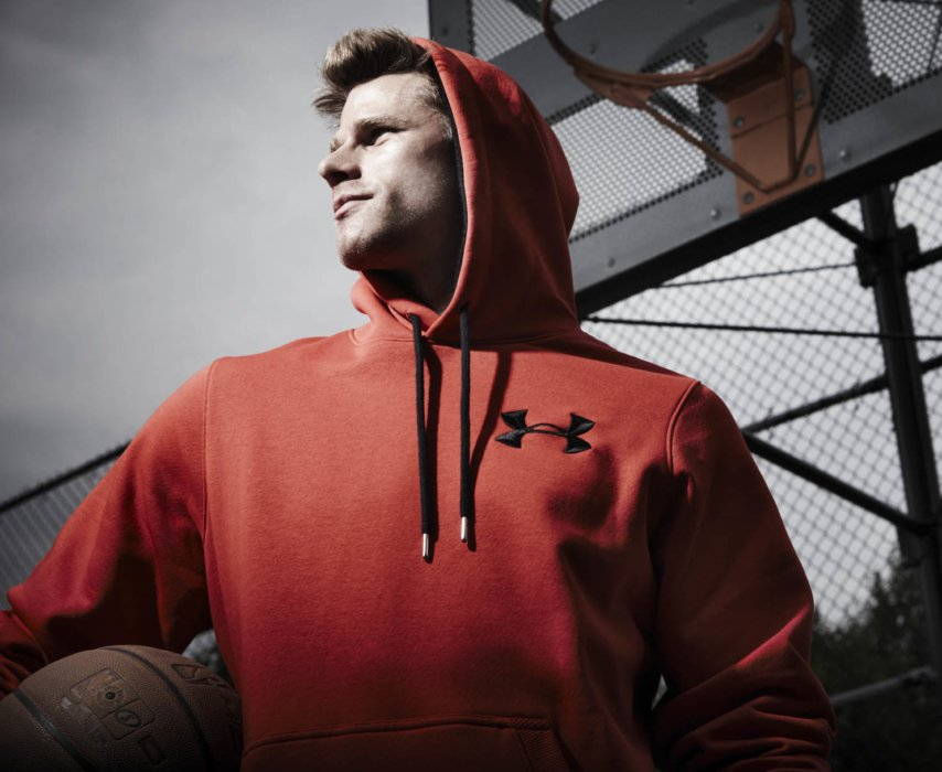 Basketball athlete portrait wearing a red hoodie