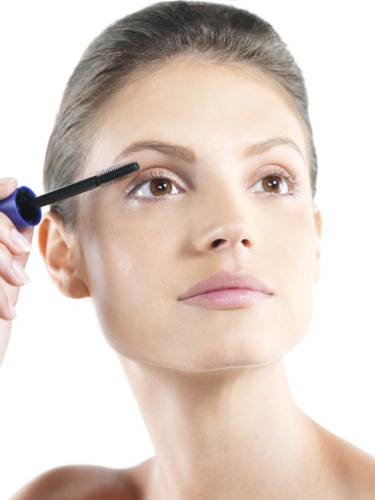 Beauty shot of a woman apply eyelash make-up