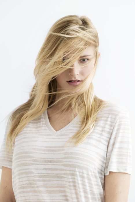 Beauty shot of a blond woman wearing a white shirt