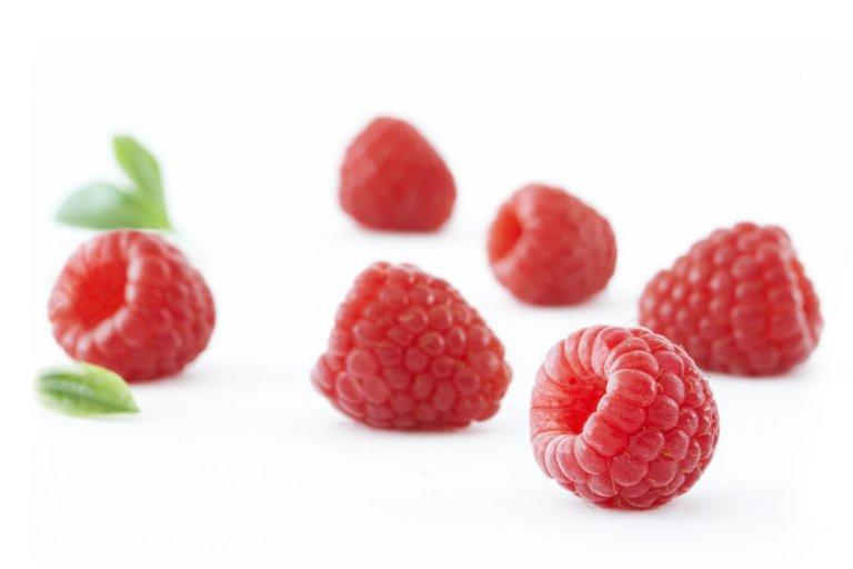 Raspberries on white background