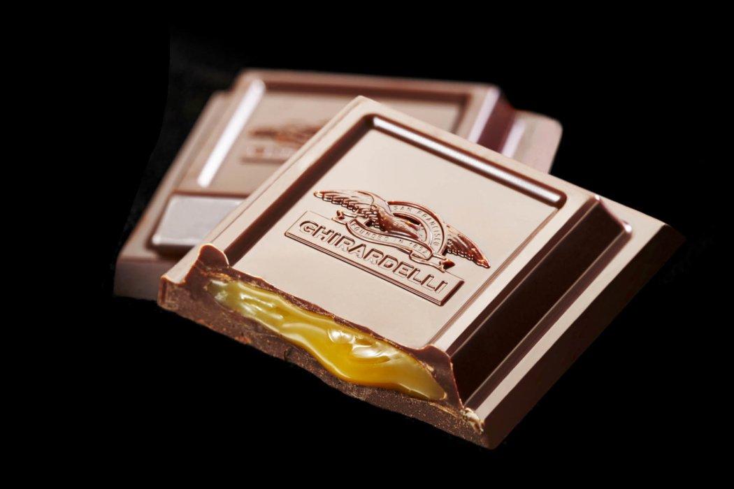 Ghirardelli filled chocolate bars on black