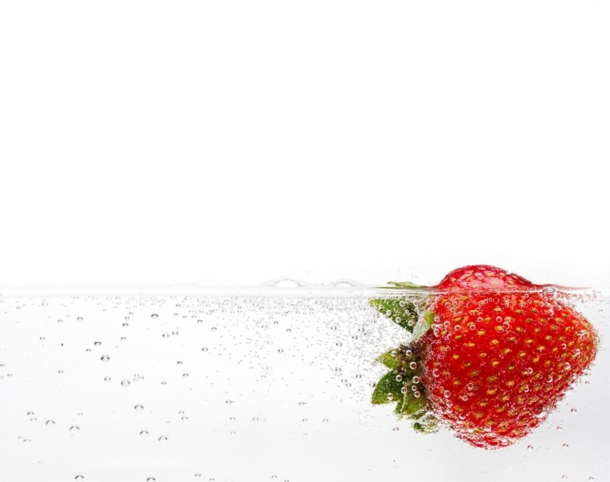 Splash and bubbles of strawberry