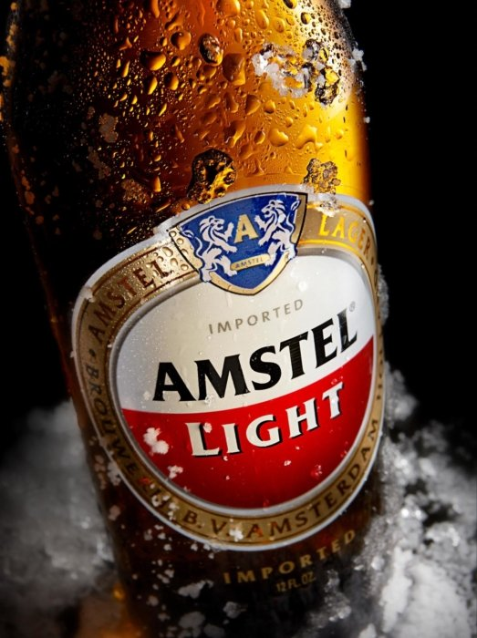 Amstel Light brown beer bottle in ice
