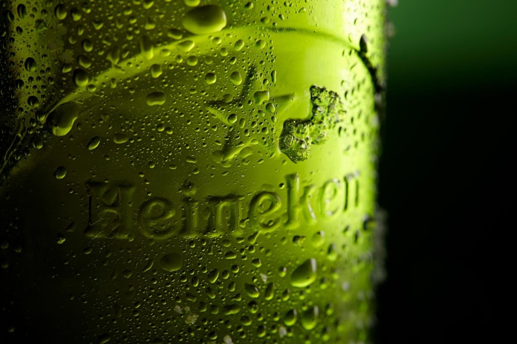 Close up Heineken beer bottle on a green background