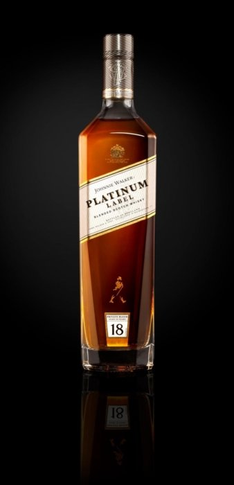 Johnnie Walker platinum label on black background. A liquor bottle image