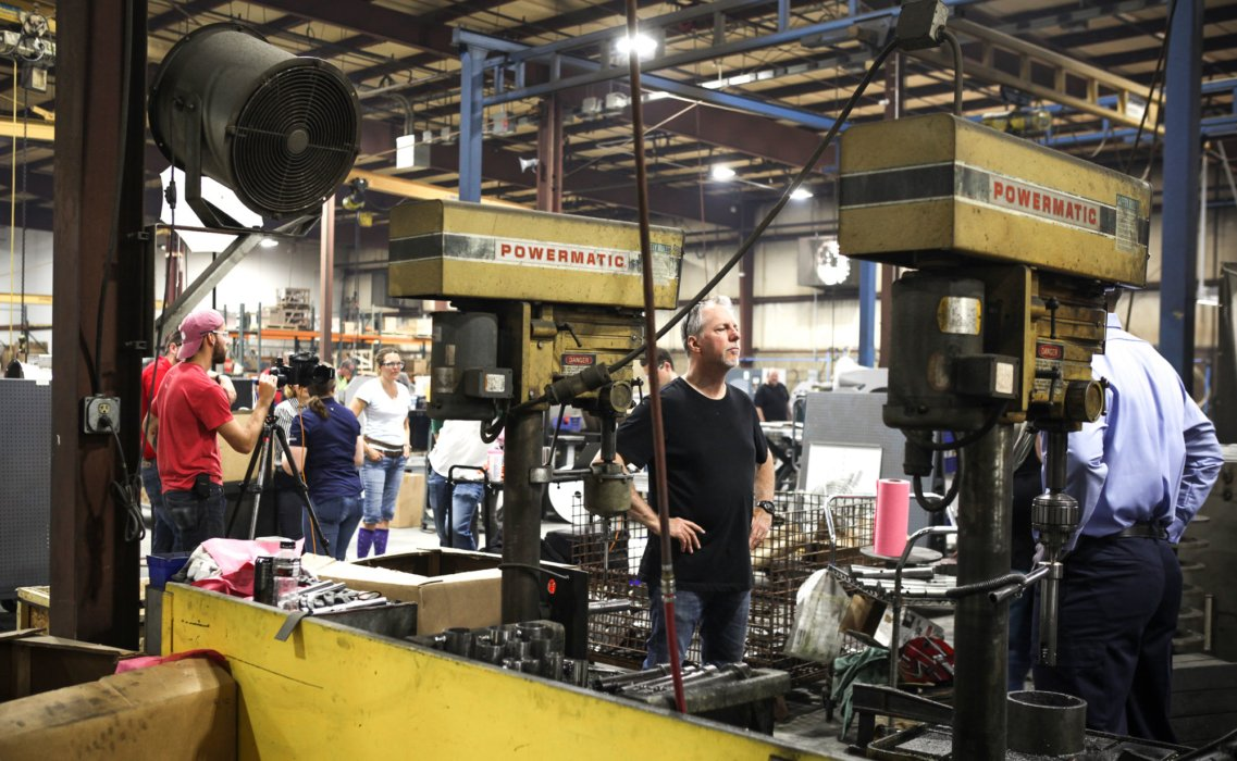 Monty Milburn directing a model at an industrial shoot