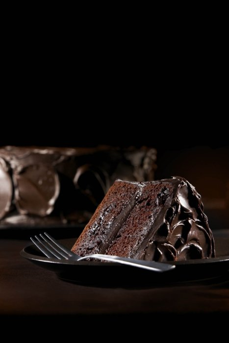 Double chocolate cake on a dark background - chocolate photography