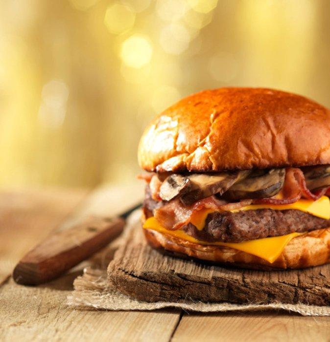 Mushroom cheese burger on a wood table
