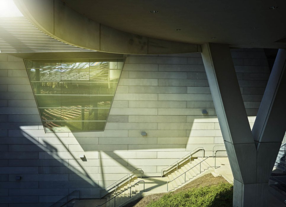 Stairs outside under a building with modern architecture