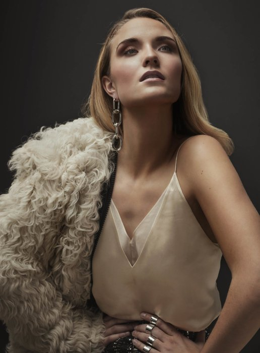 Fashion shoot of blonde woman in a fur with shoulder exposed