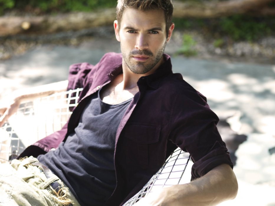 Fashion shoot of a man leaning on a hammock outdoors