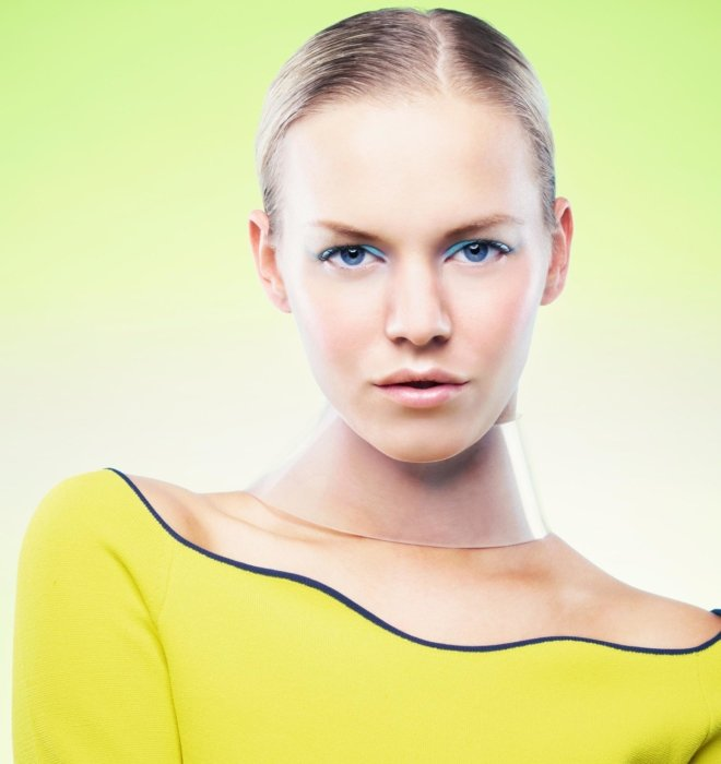 close up of a female fashion model with yellow and green