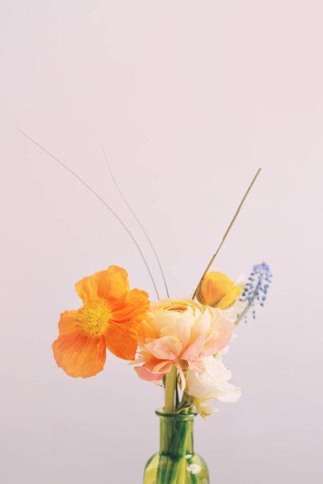 A few flowers in an arrangement in a vase