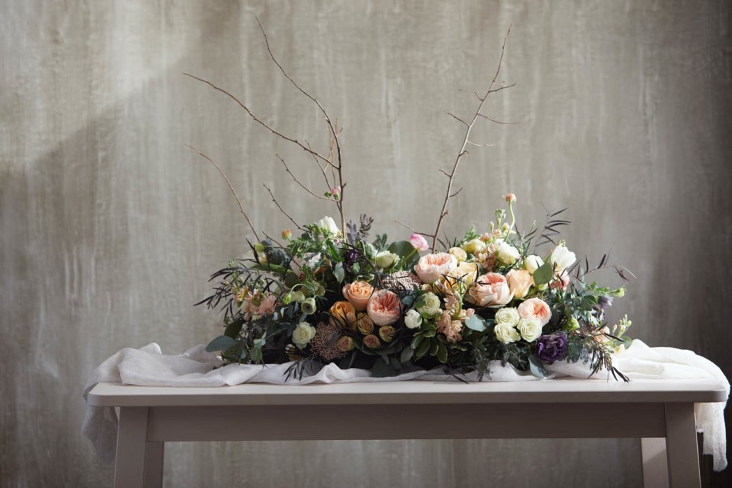 A flower arrangement on a table for a setting