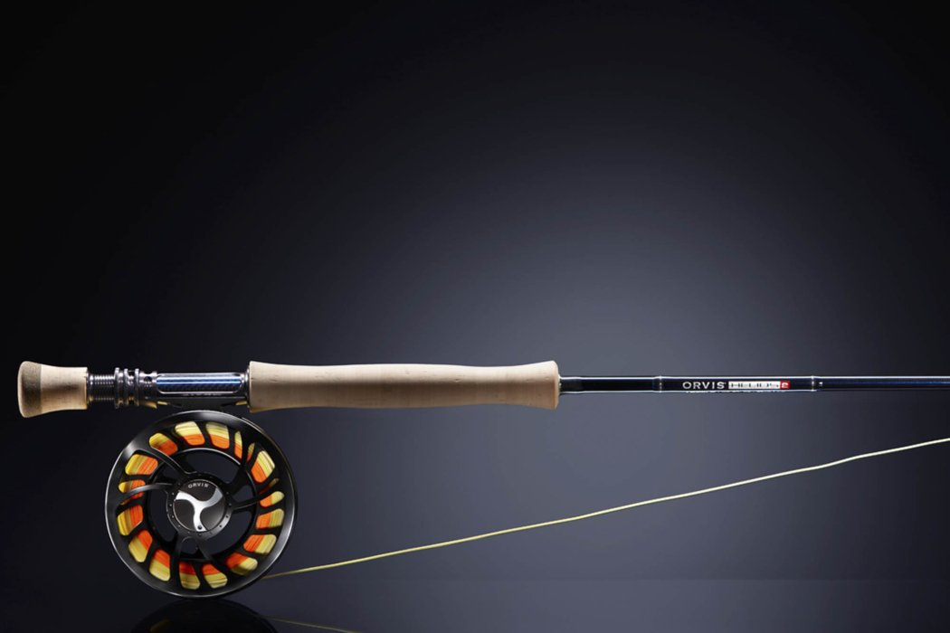 Fly fishing rod and reel on a black background
